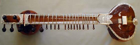 История происхождения струнного музыкального инструмента ситар, который является предком современной гитары