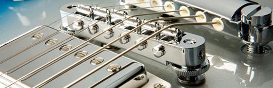 Статья о том, как правильно производится регулировка бриджа и высоты струн над грифом гитары